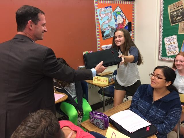 Freshman+Maeve+Mooney+receives+her+new+tablet+from+Instructional+Technology+Coordinator+Neil+MacDermot