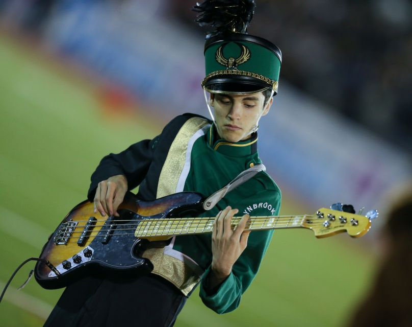 Junior Leo Glassman performs with the Marching Band and Kickline at the 55th Annual Newsday Marching Band Festival.