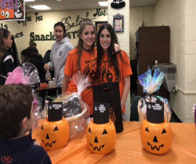 Students+gave+out+pumpkin+baskets+containing+wrapped+prizes.