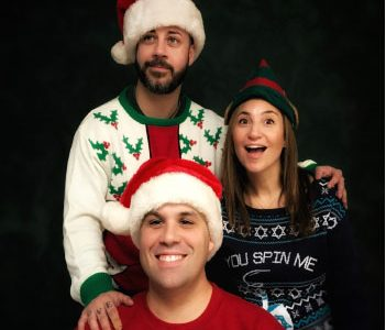 Kunz (bottom), Sena (left), and Turner (right) pose for their holiday-themed ugly sweater picture