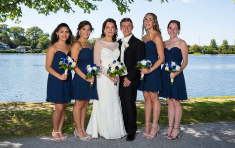 Dougherty with her daughters --- (far left), --- (left), --- (right), and --- (far right) and her new husband --- at her wedding.