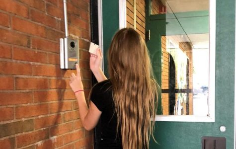 Students buzz in and present an ID in order to gain entry to the building.