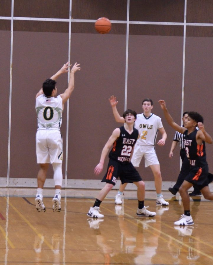 Rylan Blondo (0) takes a shot from beyond the arch.