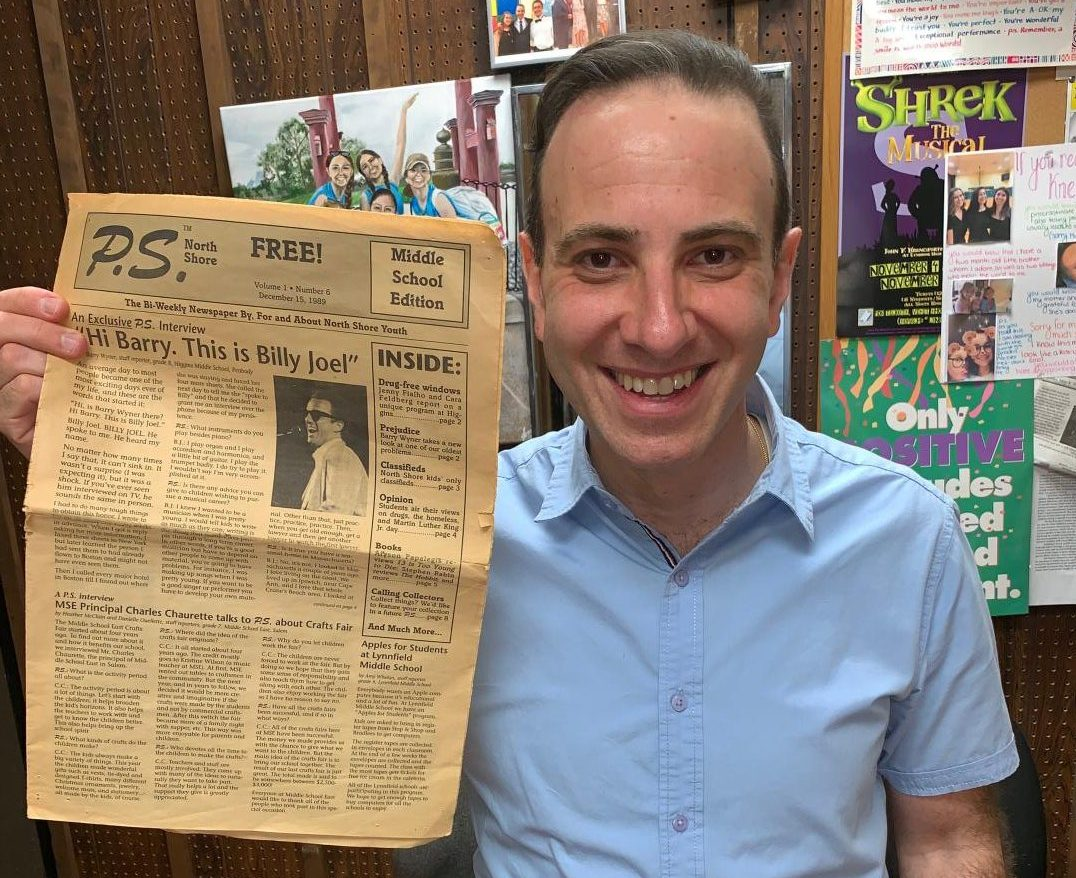 Wyner proudly displays his interview with Billy Joel in an original copy of his school newspaper printed in 1989.
