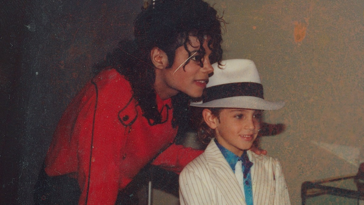 Pop superstar Michael Jackson poses with a young Wade Robson.
