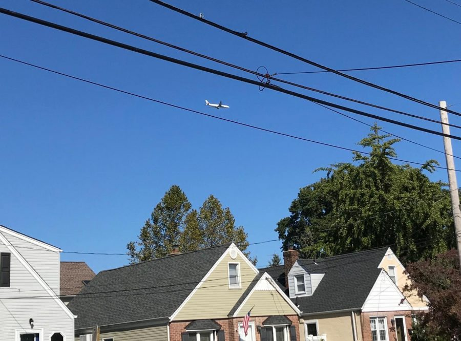 A+low-flying+plane+flying+over+Lynbrook
