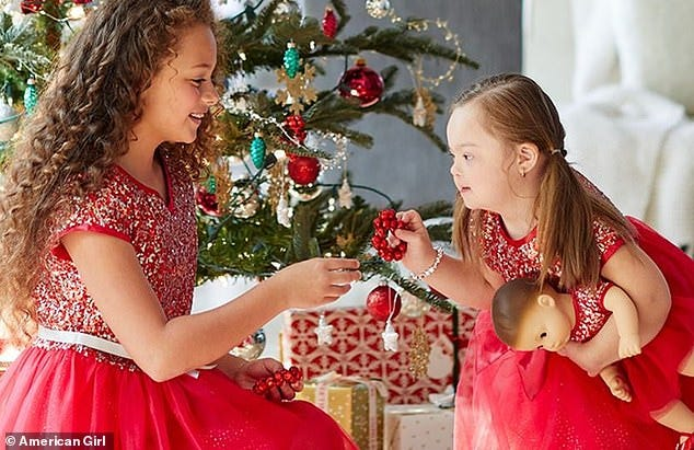 Ivy Kimble, right, is featured in the October catalog for American Girl