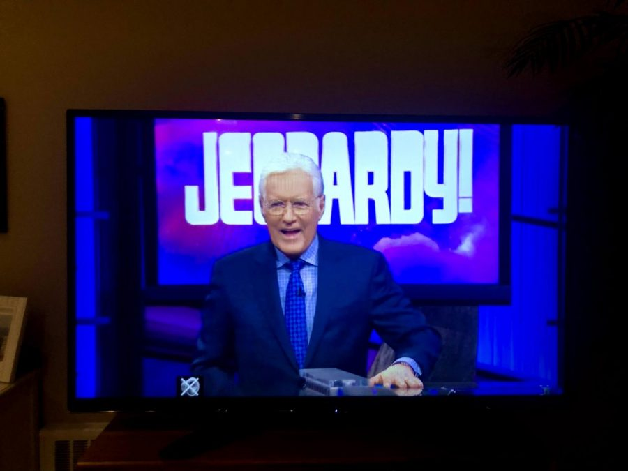 An+episode+of+Jeopardy+that+was+aired+after+Alex+Trebek%27s+passing+showing+him+sporting+a+smile+as+he+always+did.