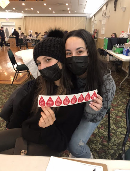 Co-presidents of LHS Key Club Carly Tucker and Marti Candel volunteering at the blood drive.