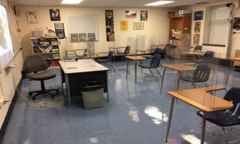 "The picture above shows what the new ""normal"" is for a high school classroom following Covid-19 safety precautions. Plastic dividers and distanced seating restrict socialization in the classroom."