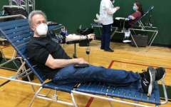Community member donating blood at the Key Club Blood Drive